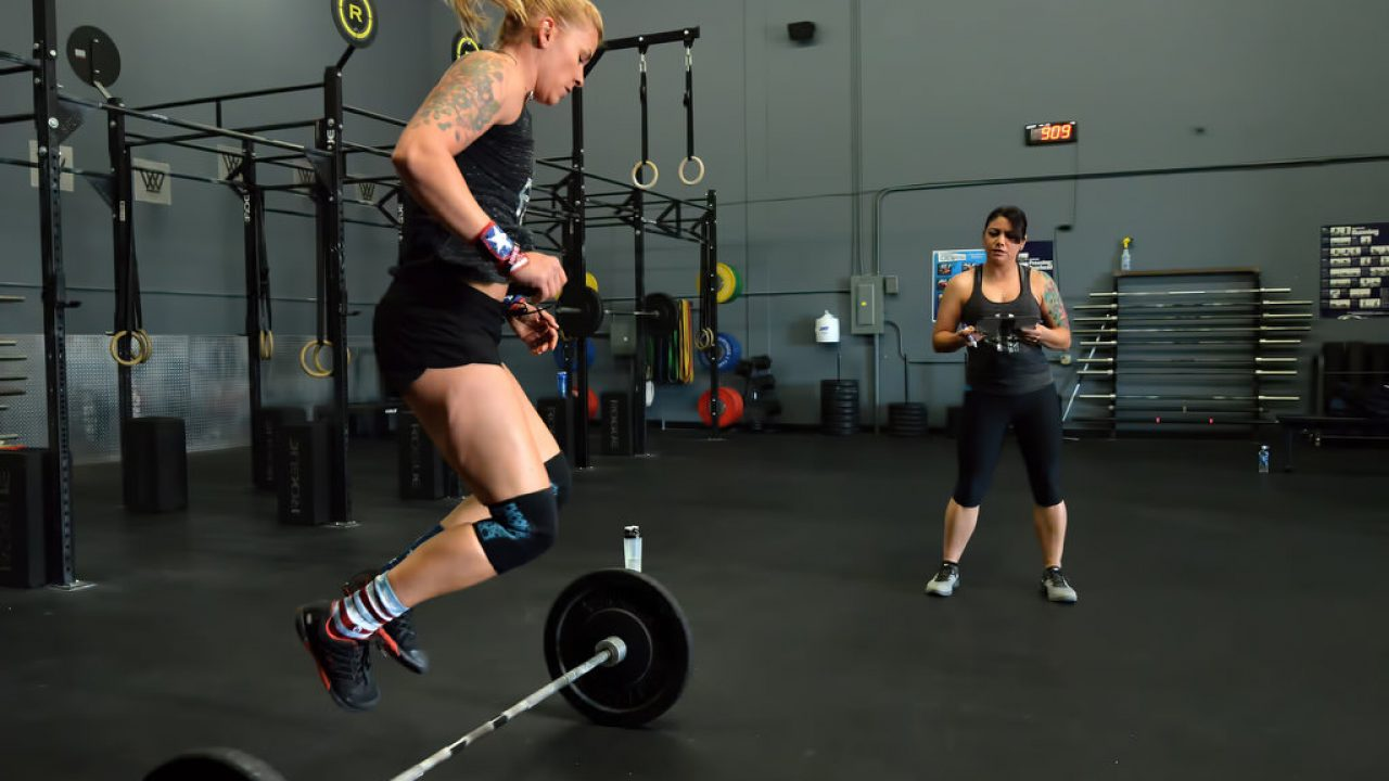 Anaheim police officers train at the CrossFit CrownTown in Corona before the Guns N Hoses Fitness Competition this coming Sunday in Anaheim.