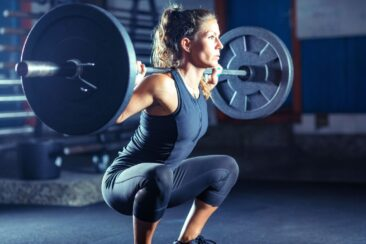 female-athlete-exercising-with-barbell-in-gym-royalty-free-image-1569411677